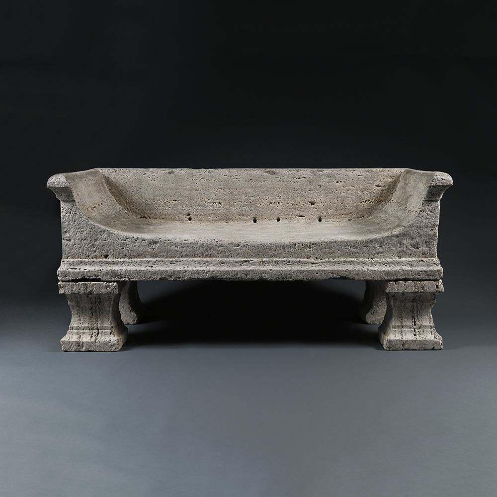 Antiques News & Fairs - BADA Fair 2017 - A bench carved out of solid travertine in the shape of an empire lit bateau by Alexander di Carcaci