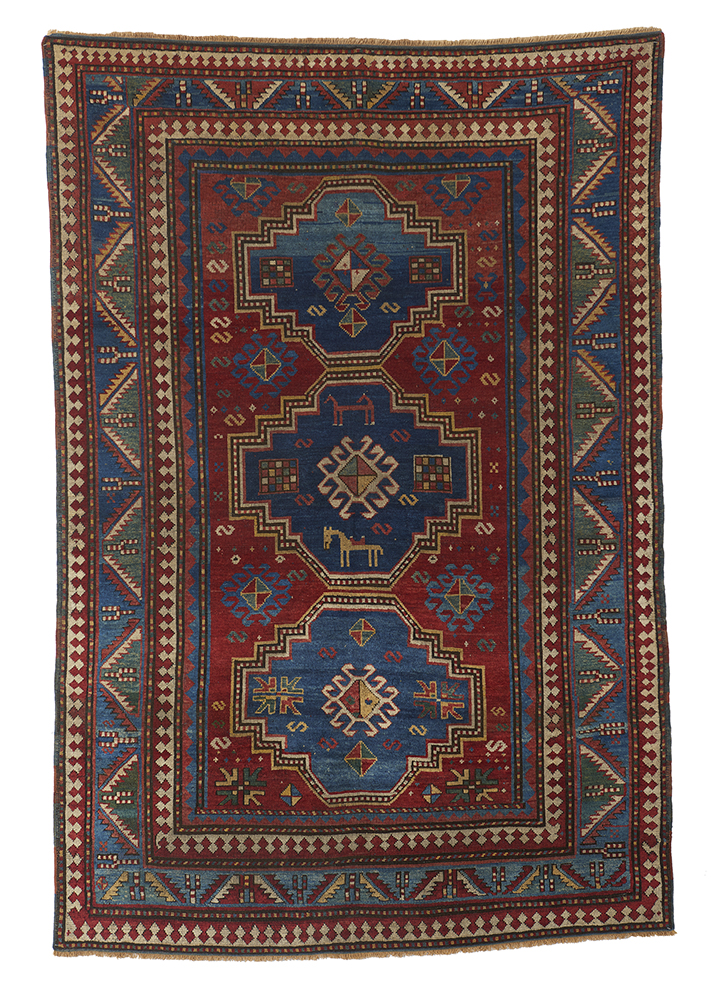 Kazak Rug with Horses, West Caucasus, late C19th, 235 x 161cm. £4500. Exhibitor: Seneh Carpets