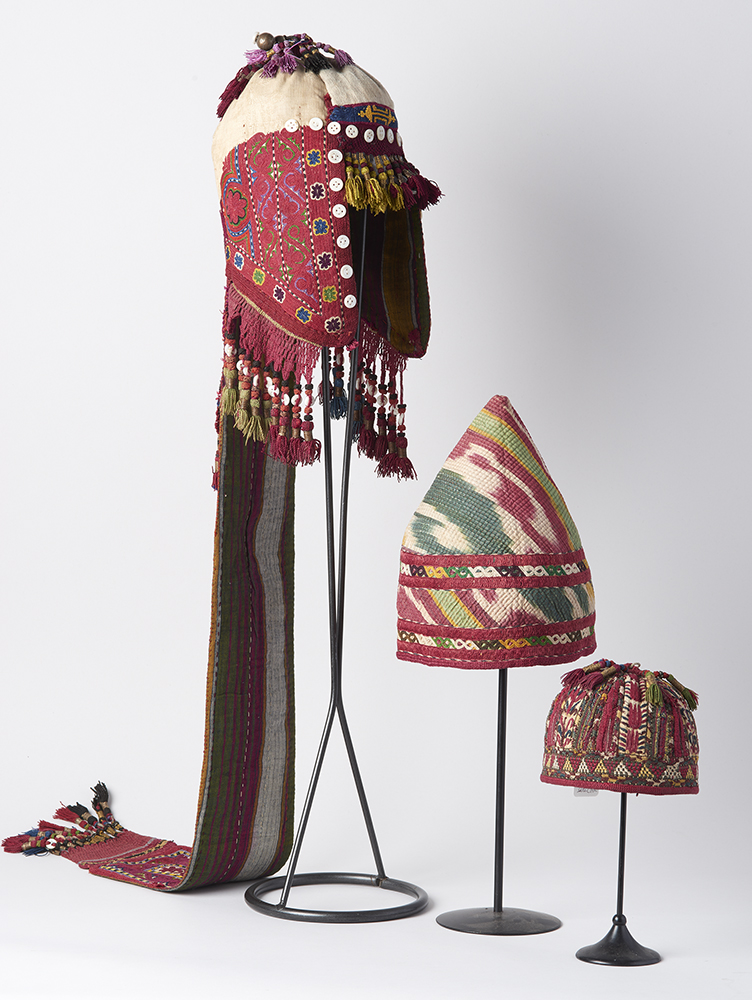 Central Asian Headdresses (Top:  Fine Silk embroidered and decorated wıth silk tasselst,  late C19th. Kirghisistan. Middle:  Fine Silk Ikat Dervish Hat from Central Asia, embroidered and quilted, late C19th. Bottom:  Fine little baby sılk embroidered and decorated hat, Tekke tribe, Turkmenistan, late C19th). Exhibitor: Turkmen Gallery