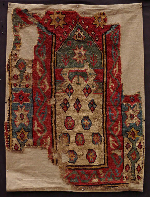 Monastir early prayer rug, from West Turkey. Has a coarse knot count, indicating that it is a village rug.  Strong tribal weaving and all natural dyes. £1500. Exhibitor: Galerie Arabesque